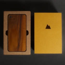 Monolith solid wood iPhone replacement back panels with laser-cut cardboard and cardstock packaging.