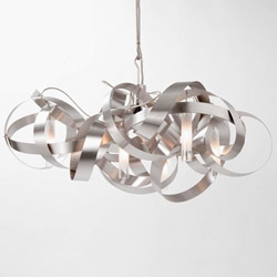I flashed over Jacco Maris' MONTONE light, made from a scribble of coiled stainless steel.