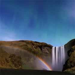 Moonbow (yes a rainbow made by the moonlight), waterfall, and aurora in Iceland! WOW. Stunning photograph by Stephane Vetter