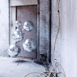 Tom Dixon does it again with this crazy mirrored ball lamp. Definitely an eye-catching statement piece!