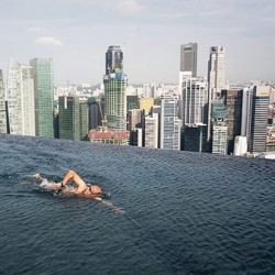 The Marina Bay Sands in Singapore welcomes visitors for the first time to the 'sands skypark', a 380 meter-long roof top deck which spans the length of the complex's three skyscrapers. Designed by architect Moshe Safdie.