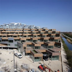 Construction progress of Mountain Dwelling, an impressive terrace housing project in top of a parking building. Gives all the benefits of a house with front yard with urban density. Located in Copenhagen, by BIG.