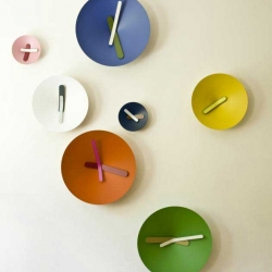 """Italian Giovanni Levanti has designed the Mozia clocks for Diamantini & Domeniconi. Levanti describes the clocks as """"Colourful Mediterranean abstraction. Clocks characterized by a wide, thin and cone-shaped face housing, in an unusual relationship...""""."""