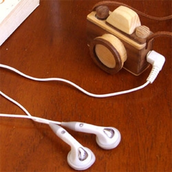 This tiny wooden camera pendant from Korea is actually an mp3 player.