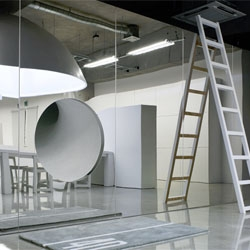 Mr_Design Office by Schemata is full of fun features, like this mirrored wall with a built in tube slide.