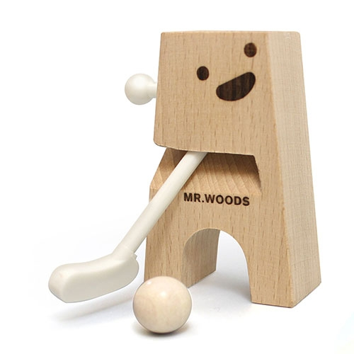 Mr. Woods by Thorsten van Elten. A wood and plastic golfer - simply push the lever and see the ball fly! Comes with two miniature wooden golf balls and a flat-pack paper obstacle course. Designed by Neue Freunde.