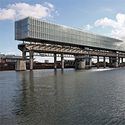 No matter how cool your office is, it will never beat the view of this office building on a dock in Amsterdam. By OTH.