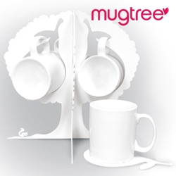 Beautiful laser-cut mugtree. I want one.