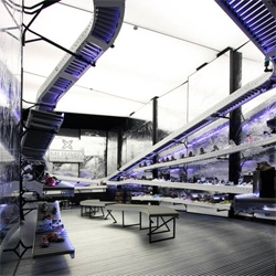 Munich La Roca shop in Barcelona by Bailo+Rull ADD arquitectura displays shoes on conveyor belts.