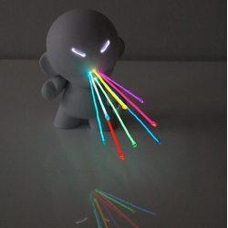 Kidrobot Munnys customized by Marcus Tremonto.  Cool light display available at Kidrobot NY on Friday.