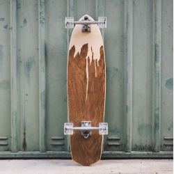 Murksli handmade longboard is handcrafted out of selected mountain maple wood and aged walnut-tree root layers.