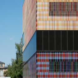 "The Museum Brandhorst in Munich, designed by Sauerbruch Hutton Architects from Berlin, is cladded with 36,000 ceramic pipes in 7 different colors. The ceramic bars are called ""Baguettes""."