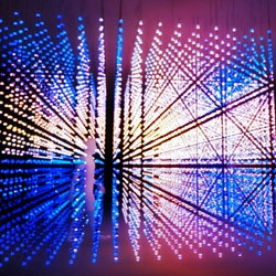 Muti Randolph's Cube, part of  today's Creators Project launch event in NYC, consists of 9,600 animated light spheres that alternate between reacting to visitors' movements and synchronizing to sound effects in a 3D space.