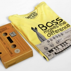 """This t-shirt includes a code to get a lifetime access to free fresh music from indie artists. You will get your tee in a special 80's tape replica package with a sticker and a handwritten """"thank you tape card""""."""