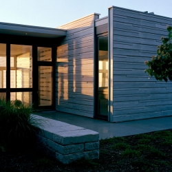 Inspired by the sea and surrounding scrub oak forest Architecture Research Office has design this modern beach house that updates New England's rich traditions with glass, zinc, and an original clapboard siding scheme