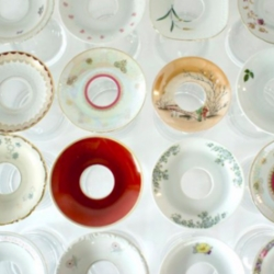Used porcelain saucers are reclaimed from European flea markets. The various saucers tell the history of European porcelain making and recycled to create unique vases by Hrafnkell Birgisson.