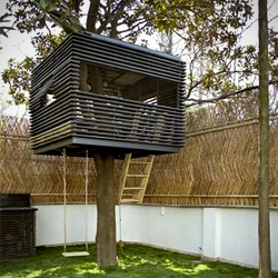 'Villa Cube' house in Shanghai  by Naço Architectures.The house features a suspended cubic tree house in the garden for children.