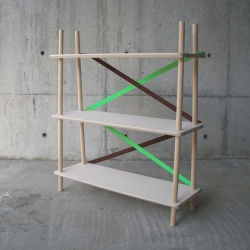 XX Shelf by Japanese designer Naoya Matsuo is held together by colored straps that are fixed with push-buttons, an unusual choice for a furniture.