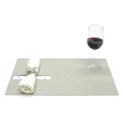 Josh Jakus' napkincatch placemat,: a holder is cut right out of the mat. Pop the attached ring out of the mat and interlock around the napkin, then tuck safely back in for easy storage.