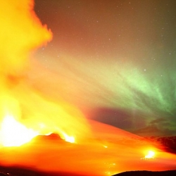 Photographer James Appleton captures two of nature's most spectacular sights - the northern lights and an erupting volcano in Iceland - in a single shot.