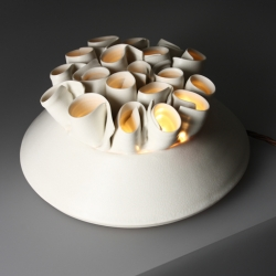 Tabletop lamp for ambient lighting which can act as a centre piece or be a beautiful lit ornament. Each lamp is porcelain, handmade and unique.