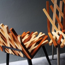 Tush Pleansuk's Nest Chair is made of golden teak and ash wood with steel mesh legs. Produced by PLATO.