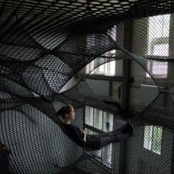 A community hammock by Numen/For Use mounted at Z33 - Huis voor actuele kunst, in Hasselt, until 2.10.2011.