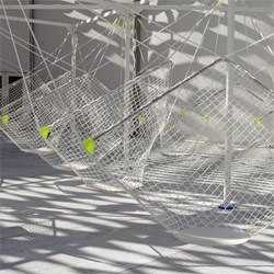 Konstantin Grcic's Netscape at Design Miami consist of suspended seats.