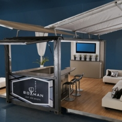 Boxman Studio's solar-powered party venue comes conveniently packed into a pop-up shipping container.
