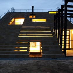 The Steps House's exterior takes the form of a huge staircase providing views and a place to lounge while the interior is illuminated by the constantly changing light provided by the unique windows.