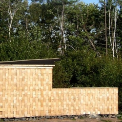 Behind this basket weave facade Richard Kroeker Design used 7000 phone books to build the walls and roof.