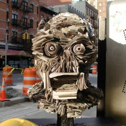 Queens-born urban artist Nick Georgiou creates organic sculptures out of old newspapers, and then deposits them in random locations around the city.