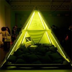 Nike Stadium in Milan ~ fun installation of florescent pyramid teepees by Super filled with pillows and tech to encourage interaction and inspiration!