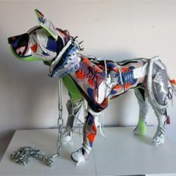 Infamous London-based artist, Vinti Andrews, has developed quite a name for herself with switch-ups and custom apparel work. This time she's created two life-sized pitbulls using Nike sneakers.