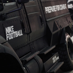 Prepare for Combat is stamped on the giant matte black armored truck at Nike Football event in Dallas.