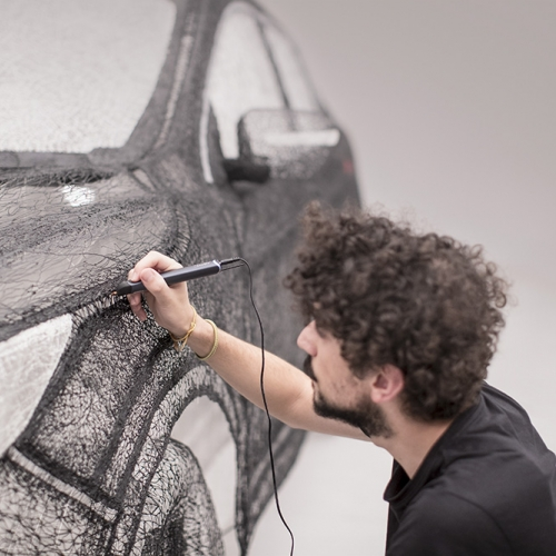 """Nissan Qashqai Black Edition: the world's largest 3D pen sculpture"" - Nissan has created a car sculpture by using a 3D pen to drawing a full-sized replica of the new Qashqai Black Edition to celebrate the car's launch."