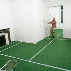 Tennis Court Apartment... French artist Benedetto Bufalino has created a tennis court over two rooms of a gallery in Dijon, complete with fake grass, white lines and a net across the doorway.