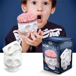 Nom Skulls ~ silicone cups... so you can totally bake cupcakes in them! Or fill them with whatever else you dream up...