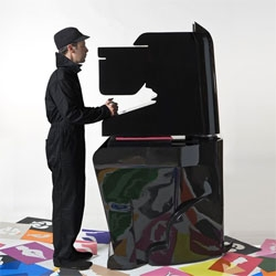 Noma Bar has created a dog-shaped machine to allow members of the public punch out shapes from large pieces of paper to create artworks.