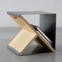 Sheet stool from Noon Studio. A simple metal sheet supported by the minimally designed wooden y-frame which can be assembled to create a unique shelving storage device.