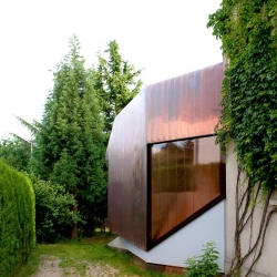 This 'copper fish' artists' studio from XSPACE has a nifty all-over copper cladding