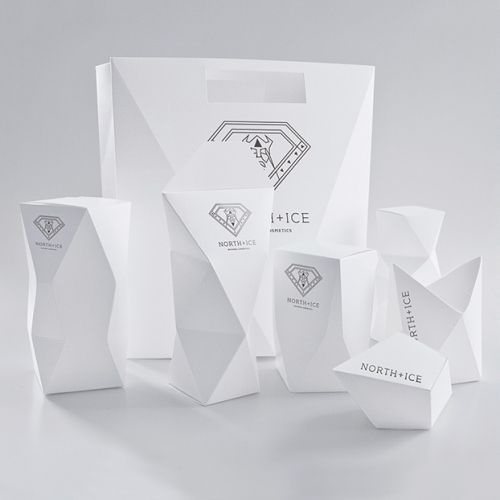 Iwona Przybyła Branding and Packaging for North + Ice. Great faceted bag and boxes, coupled with a great viking inspired logo.