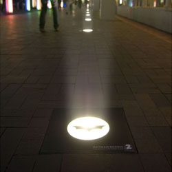 For the launch of Batman Begins on TV2, stickers were placed on footpath lights around central Auckland. At night when the lights were on, beams of light shone.