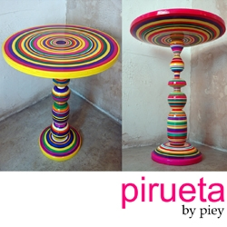 pirueta tables designed by piey (paulina gonzalez- ortega + andres ocejo) in collaboration with artisans from Mexico. The body and color is a remembrance to the wooden made mexican toys such as trompo, priinola and balero.