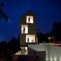 Swiss L3P architects designed a multi-family house in Regensberg, Switzerland. The architecture is defined by the location of the property with its unique panorama view and the historical reference to the castle town.