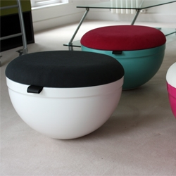 The Beeble stool designed with a hemispherical aluminum base is unique as well as functional. The upholstered lid hides a storage space, dome and base comes in many colors, and choices for the lid fabric, limitless.
