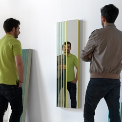 ZigZag is a magic mirror offering weather reflections of the user, or a beautiful palette of colors, depending on his position in the room. by Mut Design.