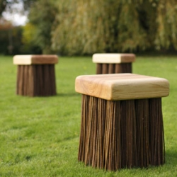 Stylish design seat that looks like a big brush.  Solid English ash top, supported by 16 bunches of willow canes. The canes bend very slightly which helps the sitter's comfort and posture.  Also works as a side table or sculpture, in the garden or indoors.