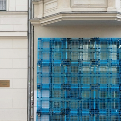REKONSTRUKTION: ornamental facade constructed from plastic disposable pallets by CANDY LENK  and ANNA BORGMAN at the Gallery Aquabit, Berlin.