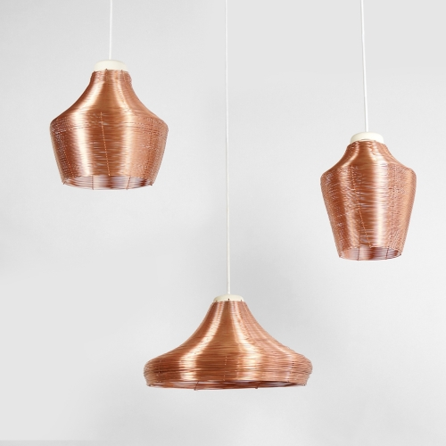 Studio Lorier designed a set of pendant lamps which are each braided from one single piece of copper wire. The wire is securely woven by hand and results in a great see-through effect. When the light is on, a warm reflection of the copper will fill the room.